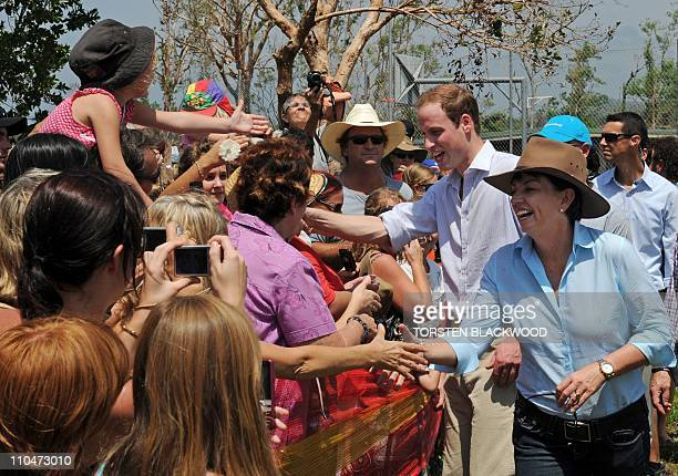 Britain's Prince William and Queensland state Premier Anna Bligh shake hands with wellwishers in the cyclonehit town of Cardwell on March 19 2011 at...