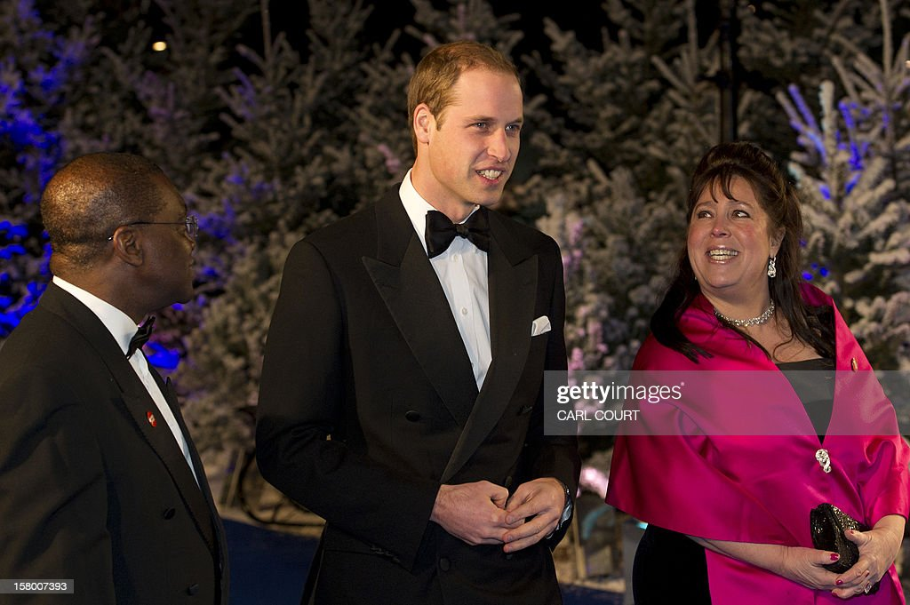Britain's Prince William, Duke of Cambridge, accompanied by Centrepoint's Chief Executive Seyi Obakin (L) and Centrepoint trustee Danielle Alexandre (R) arrives at the Winter Whites Gala in aid of the Centrepoint charity at the Royal Albert Hall in central London on December 8, 2012. The Prince attended the gala in aid of the charity of which he is patron. The London hospital that treated Prince William's pregnant wife Catherine and where a nurse was found dead after being hoaxed by an Australian radio show on Saturday wrote to the station condemning the 'truly appalling' stunt.