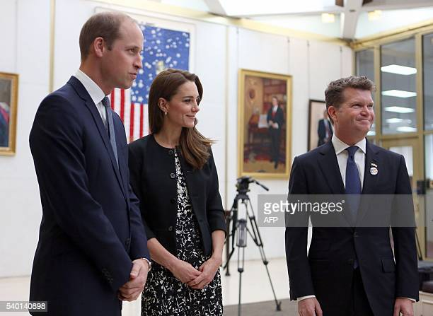 Britain's Prince William Duke of Cambridge and Britain's Catherine Duchess of Cambridge stands with Matthew Barzun US Ambassador to Britain after...