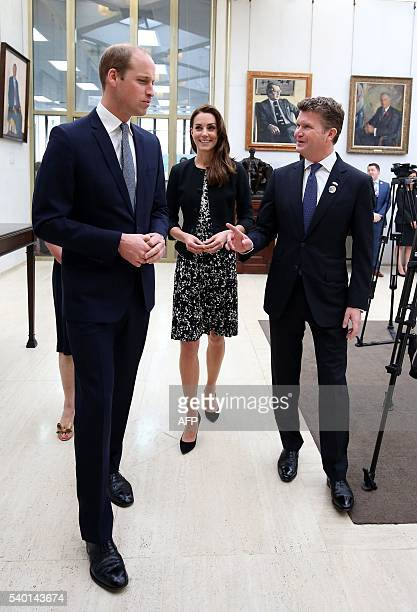 Britain's Prince William Duke of Cambridge and Britain's Catherine Duchess of Cambridge talk with Matthew Barzun US Ambassador to Britain after...