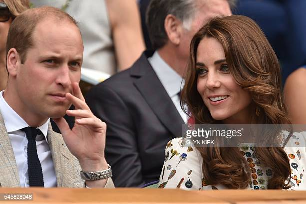 Britain's Prince William Duke of Cambridge and Britain's Catherine Duchess of Cambridge arrive in the royal box on centre court for the men's singles...