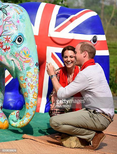 Britain's Prince William Duke of Cambridge and Catherine Duchess of Cambridge paint an elephant statue at Kaziranga Discovery Park in Panbari village...