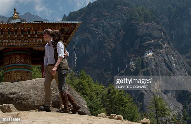 Britain's Prince William Duke of Cambridge and Catherine Duchess of Cambridge walk towards a prayer wheel after posing for a photograph halfway up...