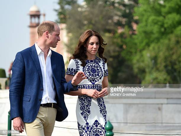 Britain's Prince William Duke of Cambridge and Catherine Duchess of Cambridge gesture as they walk during their visit to The Taj Mahal in Agra on...