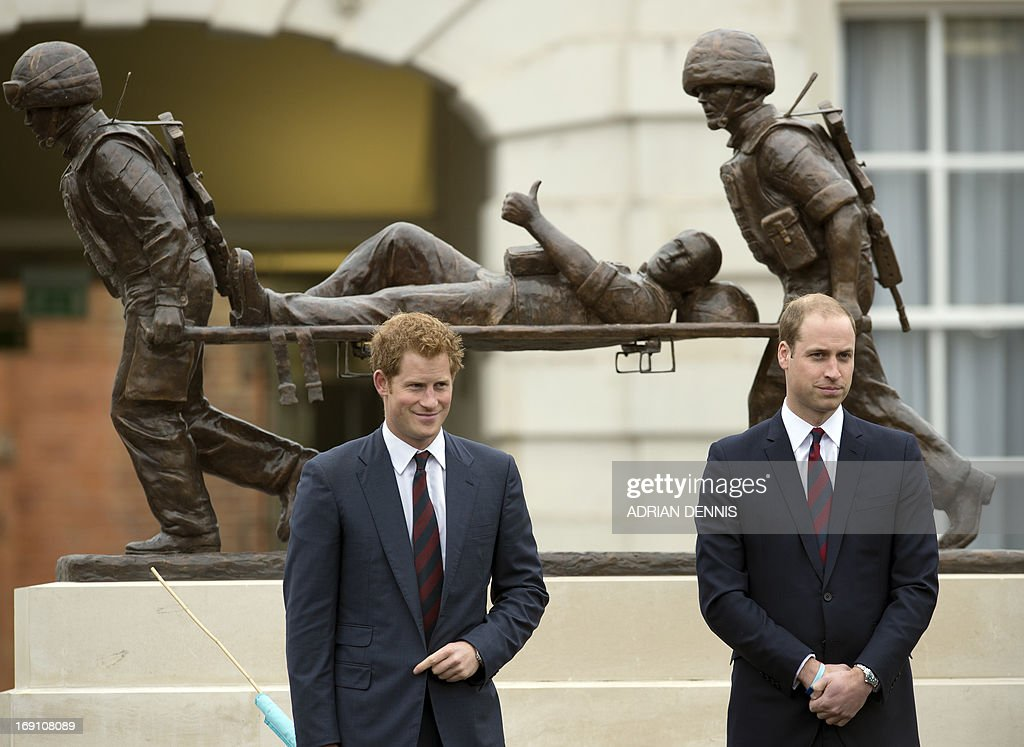 Britain's Prince William, Duke of Cambridge (R) and his brother Prince Harry (L) stand in front of a statue during a visit to Tedworth House, a recovery centre run by the Help for Heroes charity that offers care and support to injured service personnel, in Tidworth, Wiltshire, southern England, on May 20, 2013. The Duke of Cambridge and Prince Harry will officially open four new Help for Heroes recovery centres, which form part of the Defence Recovery Capability. Prince William and Harry met wounded service personnel, veterans and their families to learn about the challenges they face. Help for Heroes is building, equipping and running four recovery centres to provide ongoing support for wounded, injured and sick service personnel and veterans. Tedworth House is the first centre to open, and has the capacity to accommodate 50 residents, 4 families and over 150 day visitors.