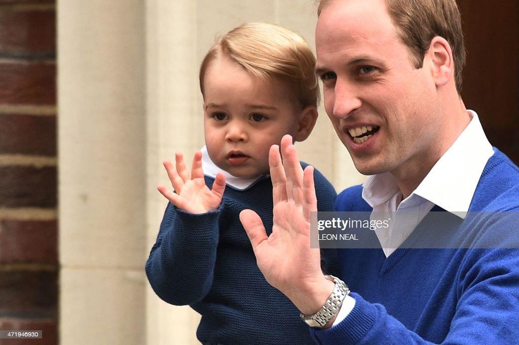 Britain's Prince William, Duke of Cambridge (R), and his son ...