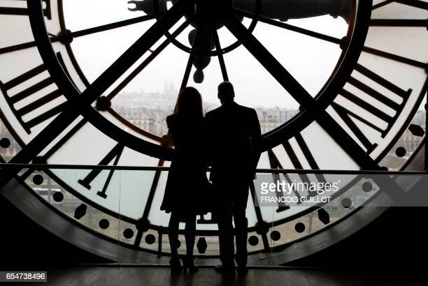 TOPSHOT Britain's Prince William Duke of Cambridge and his wife Britain's Kate Duchess of Cambridge look across the River Seine at a view of Paris...