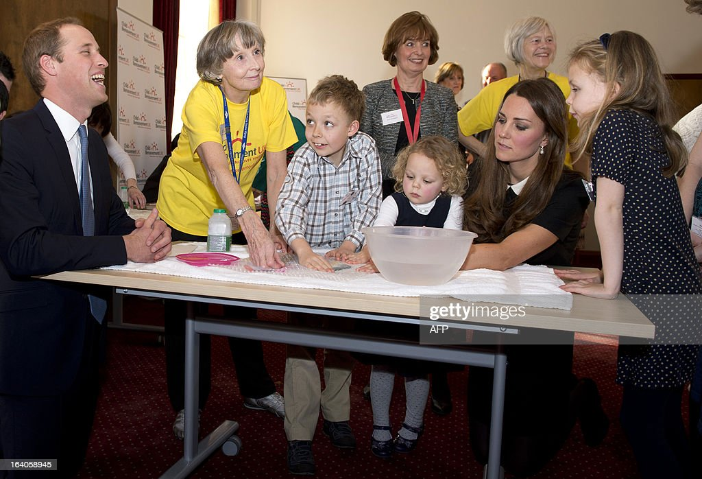Britain's Prince William (L), Duke of Cambridge, and his wife Catherine, Duchess of Cambridge, visit the Child Bereavement, in Saunderton, Buckinghamshire, on March 19, 2013.
