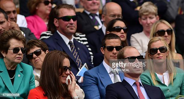 Britain's Prince William Duke of Cambridge and his wife Catherine Duchess of Cambridge wear sunglasses as they watch the action from the royal box on...
