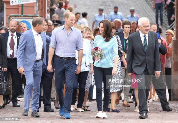 Britain's Prince William Duke of Cambridge and his wife Kate Duchess of Cambridge chat as they walk beside BadenWuerttemberg's State Premier Winfried...