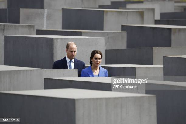 TOPSHOT Britain's Prince William Duke of Cambridge and his wife Kate the Duchess of Cambridge visit the Holocaust Memorial in Berlin on July 19 2017...