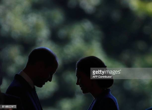 TOPSHOT Britain's Prince William Duke of Cambridge and his wife Kate the Duchess of Cambridge visits the Bellevue Palace garden in Berlin on July 19...