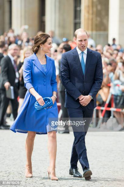 Britain's Prince William Duke of Cambridge and his wife Kate the Duchess of Cambridge walk in front of Brandenburg Gate in Berlin on July 19 2017