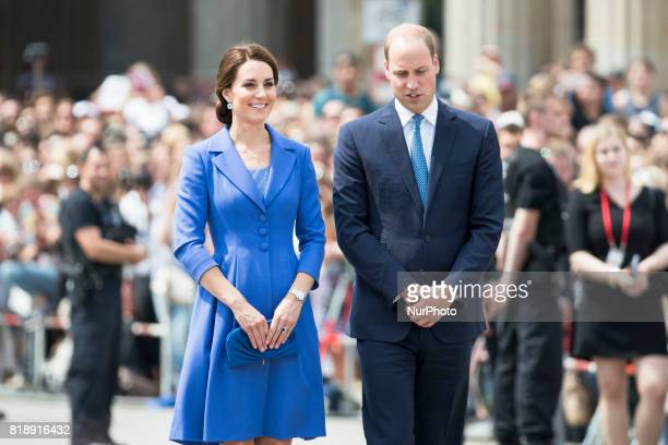 Britain's Prince William Duke of Cambridge and his wife Kate the Duchess of Cambridge pose for a picture in front of Brandenburg Gate in Berlin on...