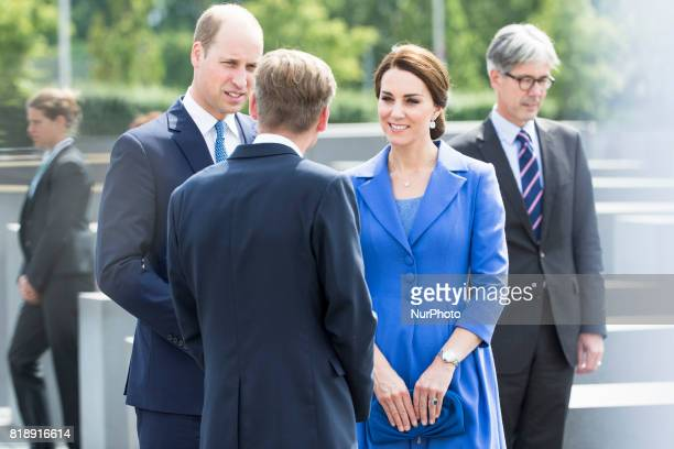 Britain's Prince William Duke of Cambridge and his wife Kate the Duchess of Cambridge arrive at the Holocaust Memorial in Berlin on July 19 2017