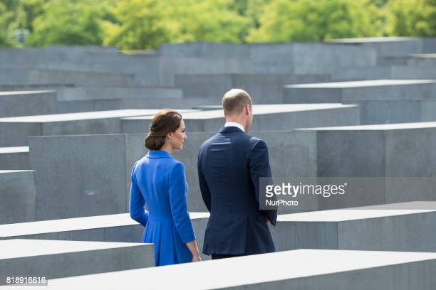 Britain's Prince William Duke of Cambridge and his wife Kate the Duchess of Cambridge visit the Holocaust Memorial in Berlin on July 19 2017