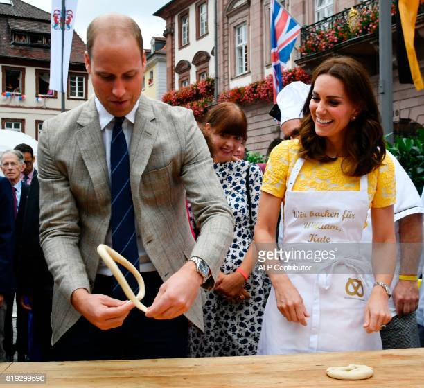Britain's Prince William Duke of Cambridge and his wife Kate the Duchess of Cambridge form pastry to prezels during their visit of the market in the...