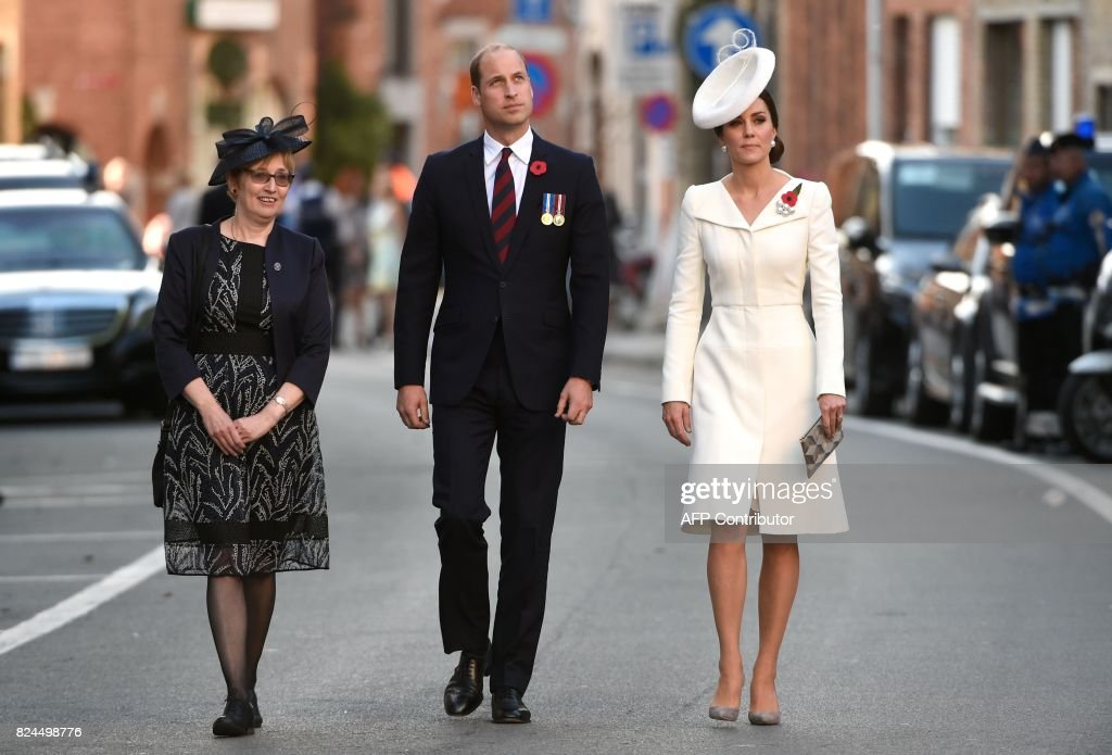 Britain's Prince William (C), Duke of Cambridge and his wife Kate, the Duchess of Cambridge, arrive to attend a ceremony marking the centenary of the battle of Passchendaele, one of the bloodiest of World War I during the Last Post ceremony at the Commonwealth War Graves Commission in Ypres (Menin Gate) Memorial, in Ypres Western Flanders on July 30, 2017. The battle of Passchendaele, also called the third battle of Ypres, took place between July 31 and November 6, 1917 in Passendale, West Flanders. /