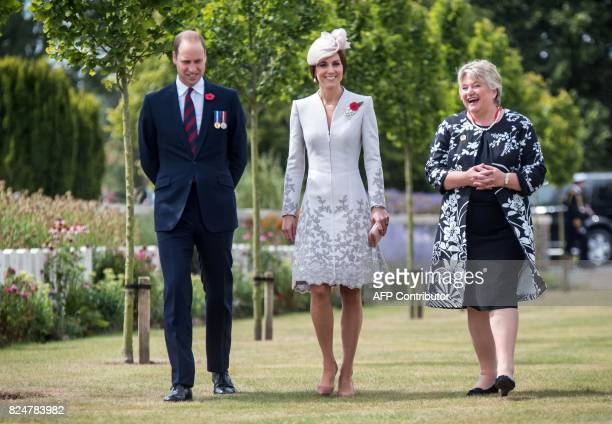 Britain's Prince William Duke of Cambridge and his wife Kate the Duchess of Cambridge speak with Commonwealth War Graves Commission Director General...