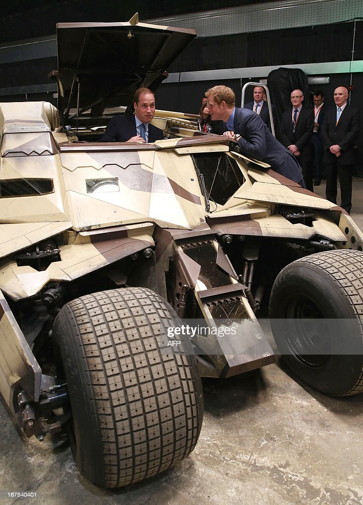 Britain's Prince William (L), Duke of Cambridge, and Prince Harry chek-out a 'Tumbler', a vehicle used in the Batman films, during the Inauguration Of Warner Bros Studios in Leavesden, north London, on April 26, 2013.