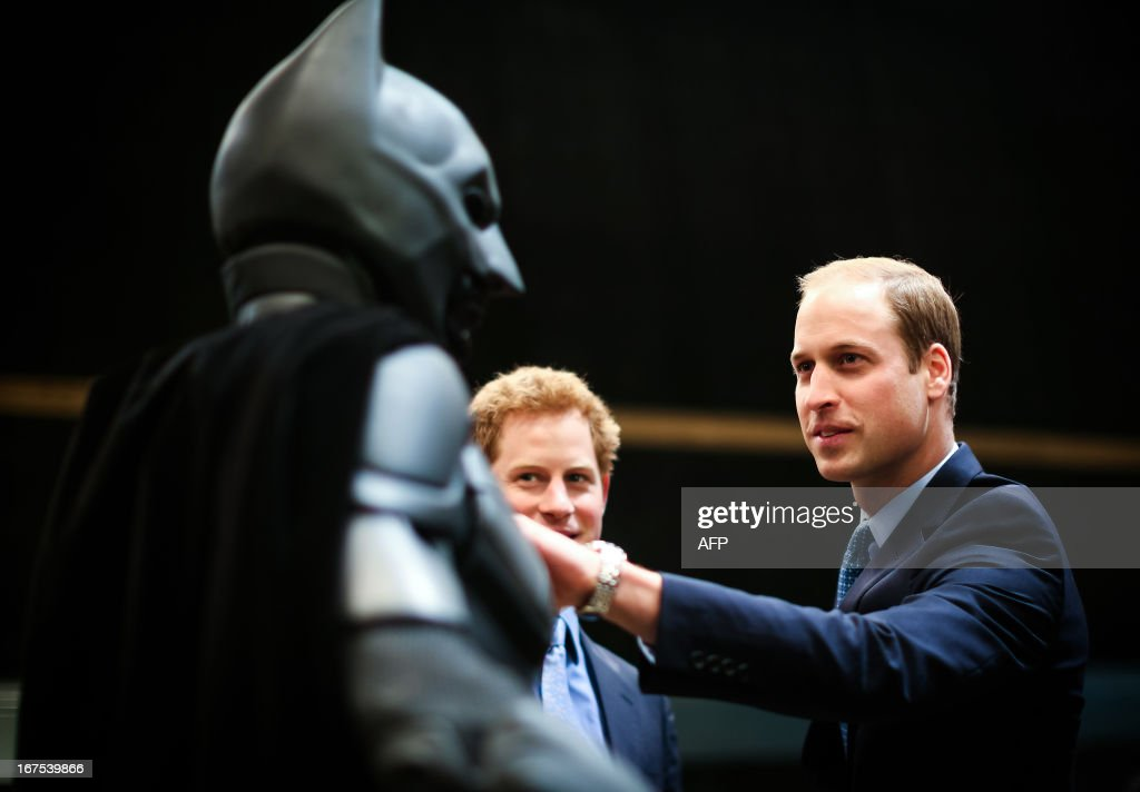 Britain's Prince William, Duke of Cambridge, and Prince Harry look at a 'Batsuit' which was used in the Batman films during the Inauguration Of Warner Bros Studios in Leavesden, north London, on April 26, 2013.