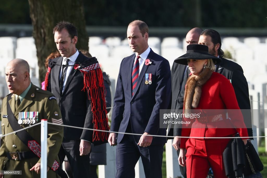 Britain's Prince William, Duke of Cambridge (C) and Princess Astrid of Belgium (R) attends the commemoration of the WWI Battle of Passchendaele on October 12, 2017 at the Tyne Cot Commonwealth War Graves Cemetery, in Passendale. New Zealand is commemorating on October 12 the centenary of the World War I Battle of Passchendaele. / AFP PHOTO / BELGA AND Belga / KURT DESPLENTER / Belgium OUT