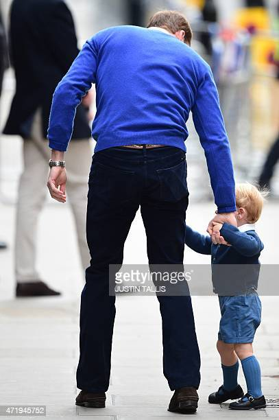 Britain's Prince William Duke of Cambridge attempts to walk with his son Prince George of Cambridge as they return to the Lindo Wing at St Mary's...