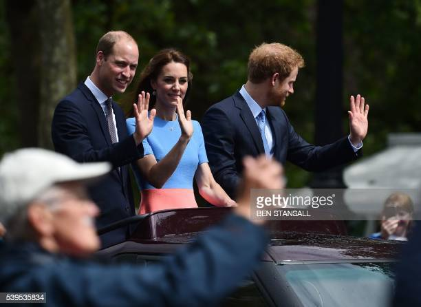 Britain's Prince William Duke of Cambridge Britain's Catherine Duchess of Cambridge and Britain's Prince Harry wave to guests at the Patron's Lunch a...