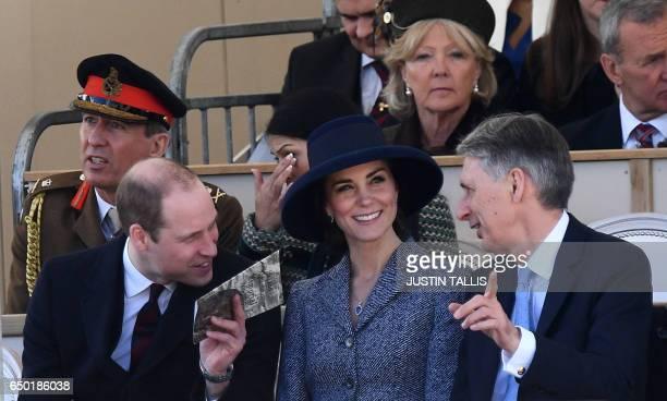 Britain's Prince William Duke of Cambridge Britain's Catherine Duchess of Cambridge and British Chancellor of the Exchequer Philip Hammond chat as...