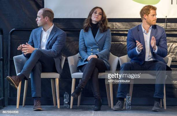 Britain's Prince William Duke of Cambridge Britain's Catherine Duchess of Cambridge and Britain's Prince Harry gesture during their visit to attend...