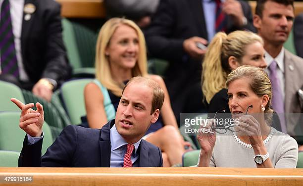 Britain's Prince William Duke of Cambridge gesture as he talks with Sophie Countess of Wessex in the royal box on centre court during the men's...