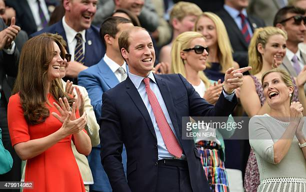 Britain's Prince William Duke of Cambridge gestures next to his wife Catherine Duchess of Cambridge and Sophie Countess of Wessex as he watches a...