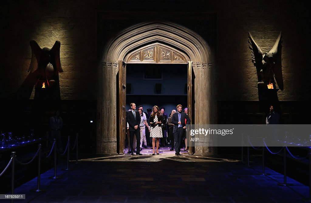 Britain's Prince William (L), Duke of Cambridge, his wife Catherine (C), Duchess of Cambridge, and brother Prince Harry (R) walk through the set used to depict Hogwarts' Great Hall in the Harry Potter films during the Inauguration Of Warner Bros Studios in Leavesden, north London, on April 26, 2013.