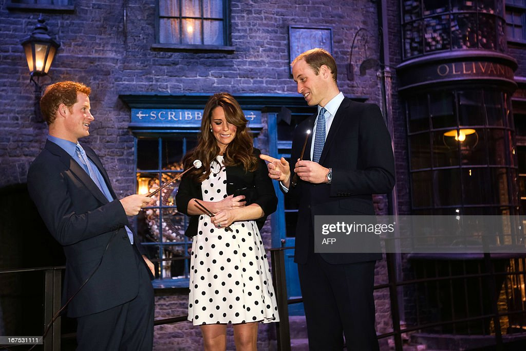 Britain's Prince William (R), Duke of Cambridge, his wife Catherine, Duchess of Cambridge, and brother Prince Harry try some wands on the set used to depict Diagon Alley in the Harry Potter films during the Inauguration Of Warner Bros Studios in Leavesden, north London, on April 26, 2013.
