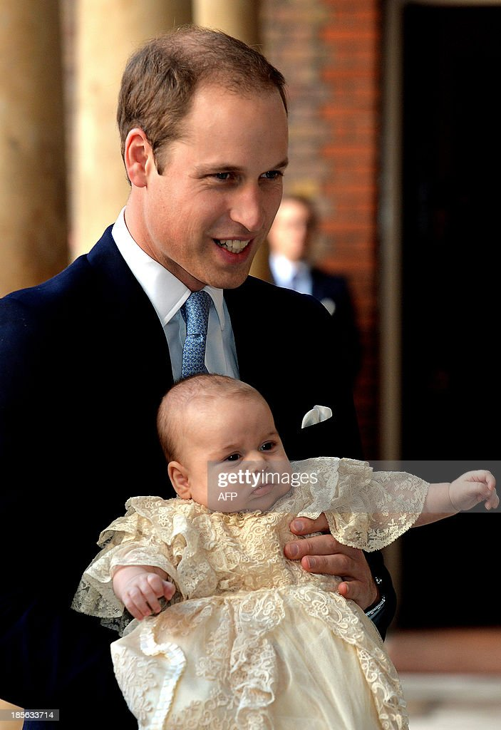 Britain's Prince William, Duke of Cambridge holds his son, Prince George of Cambridge, as he arrives at Chapel Royal in St James's Palace in central London for the christening of the three month-old baby on October 23, 2013. Prince William and his wife Catherine gather close friends and family on Wednesday for the christening of their baby son Prince George, in a low-key ceremony far removed from the global hype surrounding their wedding.