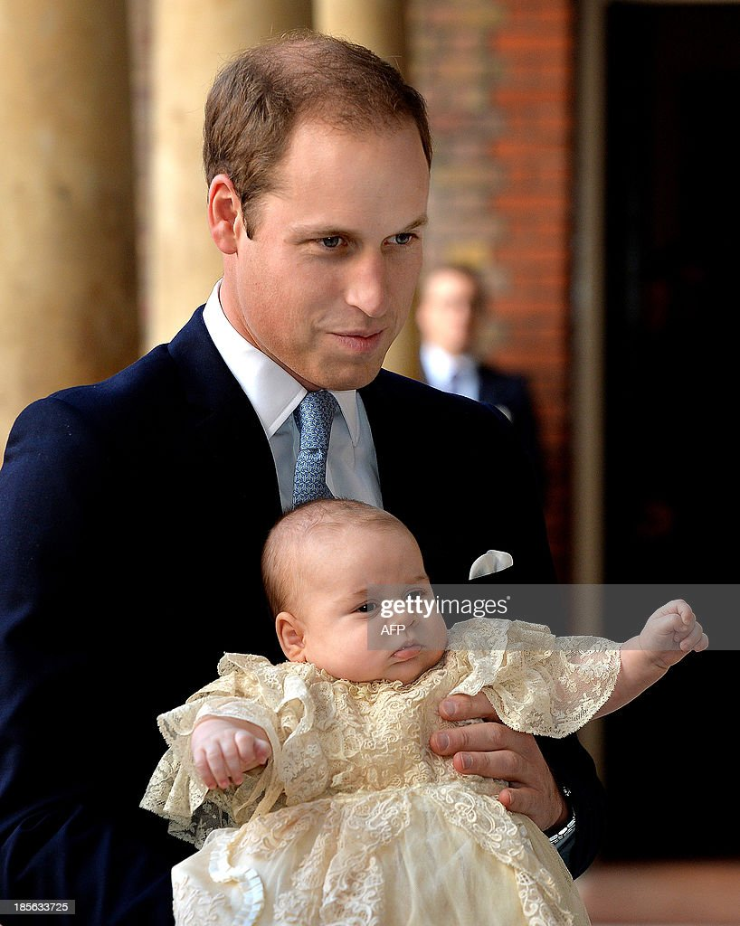 Britain's Prince William, Duke of Cambridge holds his son, Prince George of Cambridge, as he arrives at Chapel Royal in St James's Palace in central London for the christening of the three month-old baby on October 23, 2013. Prince William and his wife Catherine gather close friends and family on Wednesday for the christening of their baby son Prince George, in a low-key ceremony far removed from the global hype surrounding their wedding. AFP PHOTO/POOL/JOHN STILLWELL