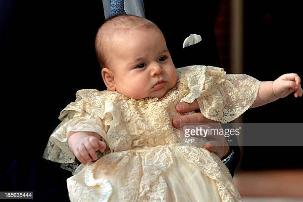 Britain's Prince William Duke of Cambridge holds his son Prince George of Cambridge as he arrives at Chapel Royal in St James's Palace in central...