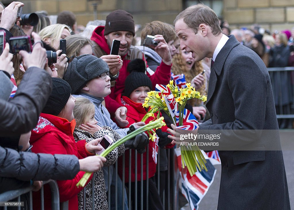 Britain's Prince William, Duke of Cambridge, meets well-wishers during his visit to Cambridge, north of London, on November 28, 2012. Britain's Prince William and his wife Catherine visited the university city that is home to their dukedom on November 28 for the first time since they were given their official titles. AFP PHOTO / POOL / ARTHUR EDWARDS