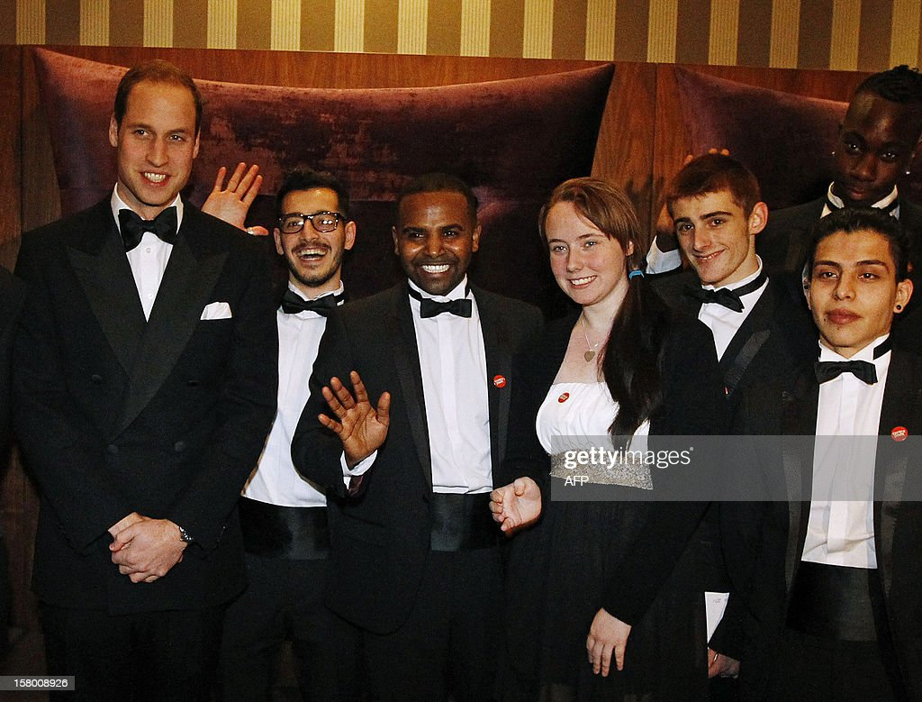 Britain's Prince William, Duke of Cambridge (L) poses with people from the homeless charity Centrepoint, at the Winter Whites Gala in aid of the Centrepoint charity at the Royal Albert Hall in central London on December 8, 2012. The Prince attended the gala in aid of the charity of which he is patron. The London hospital that treated Prince William's pregnant wife Catherine and where a nurse was found dead after being hoaxed by an Australian radio show on Saturday wrote to the station condemning the 'truly appalling' stunt. AFP PHOTO / POOL / LUKE MACGREGOR