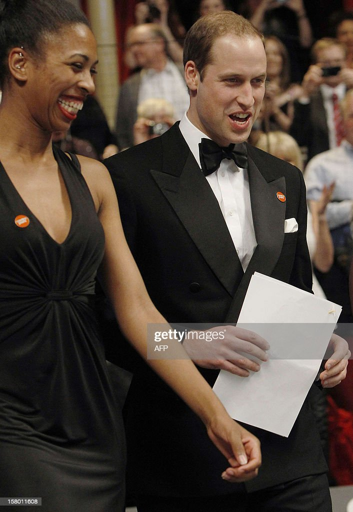 Britain's Prince William, Duke of Cambridge (R), prepares to make a speech at the Winter Whites Gala in aid of the Centrepoint charity at the Royal Albert Hall in central London on December 8, 2012. The Prince attended the gala in aid of the charity of which he is patron. The London hospital that treated Prince William's pregnant wife Catherine and where a nurse was found dead after being hoaxed by an Australian radio show on Saturday wrote to the station condemning the 'truly appalling' stunt. AFP PHOTO / POOL / LUKE MACGREGOR