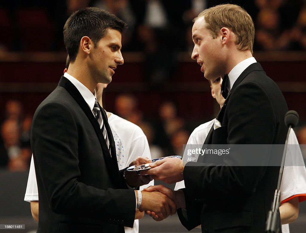 Britain's Prince William, Duke of Cambridge (R) presents world number one tennis player, Serbia's Novak Djokovic (L) with the 'Centrepoint Premier Award for Contribution to the Lives of Youth Across the World' in recognition of his Novak Djokavic Foundation at the Winter Whites Gala in aid of the Centrepoint charity at the Royal Albert Hall in central London on December 8, 2012. The Prince attended the gala in aid of the charity of which he is patron. The London hospital that treated Prince William's pregnant wife Catherine and where a nurse was found dead after being hoaxed by an Australian radio show on Saturday wrote to the station condemning the 'truly appalling' stunt.