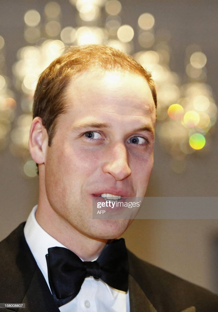 Britain's Prince William, Duke of Cambridge reacts as he meets people at the Winter Whites Gala in aid of the Centrepoint charity at the Royal Albert Hall in central London on December 8, 2012. The Prince attended the gala in aid of the charity of which he is patron. The London hospital that treated Prince William's pregnant wife Catherine and where a nurse was found dead after being hoaxed by an Australian radio show on Saturday wrote to the station condemning the 'truly appalling' stunt. AFP PHOTO / POOL / LUKE MACGREGOR