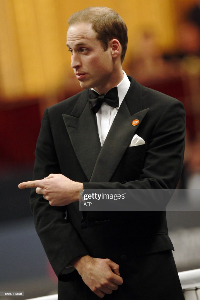 Britain's Prince William, Duke of Cambridge reacts during speeches at the Winter Whites Gala in aid of the Centrepoint charity at the Royal Albert Hall in central London on December 8, 2012. The Prince attended the gala in aid of the charity of which he is patron. The London hospital that treated Prince William's pregnant wife Catherine and where a nurse was found dead after being hoaxed by an Australian radio show on Saturday wrote to the station condemning the 'truly appalling' stunt.