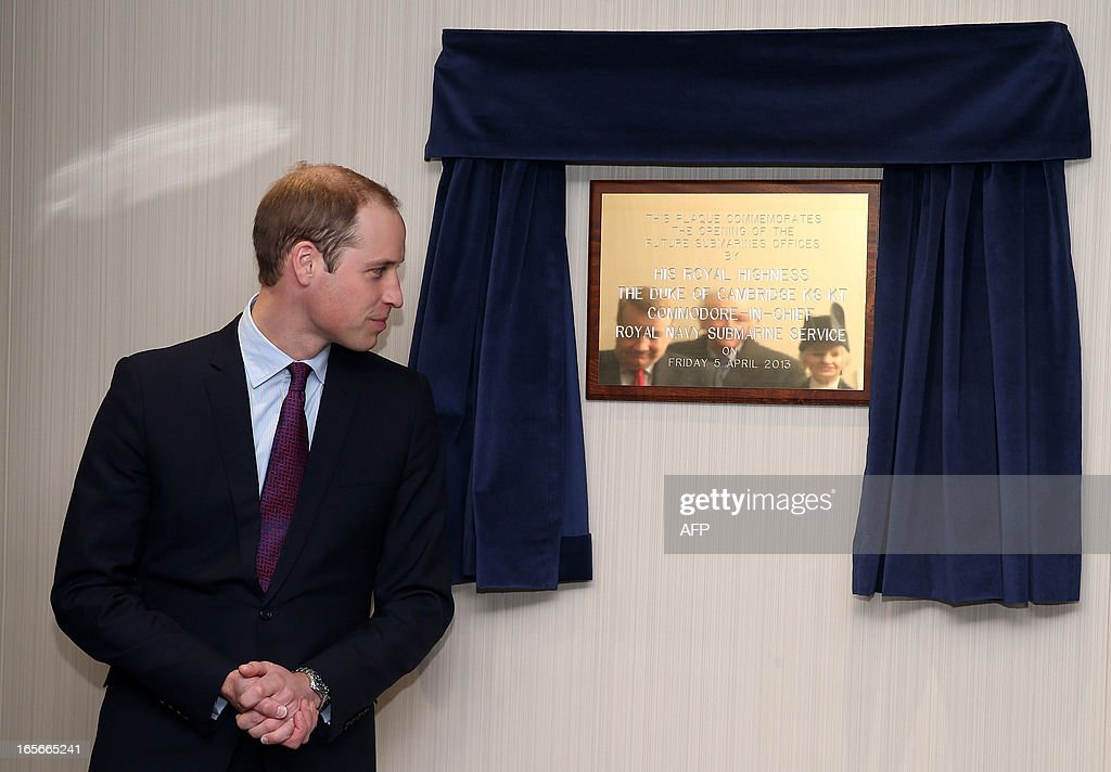 Britain's Prince William, Duke of Cambridge (L) reveals a plaque to commemorate the opening of the Future Submarines Offices during a visit to the Astute-class Submarine Building at BAE Systems in Barrow-in-Furness, Cumbria, northern England, on April 5, 2013. The Duke of Cambridge is Commodore-in-Chief of the Royal Navy Submarine Service and during their visit they toured the offices of Vanguard replacement programme and meet with the crew of Artful and their families, who are now based in Barrow.