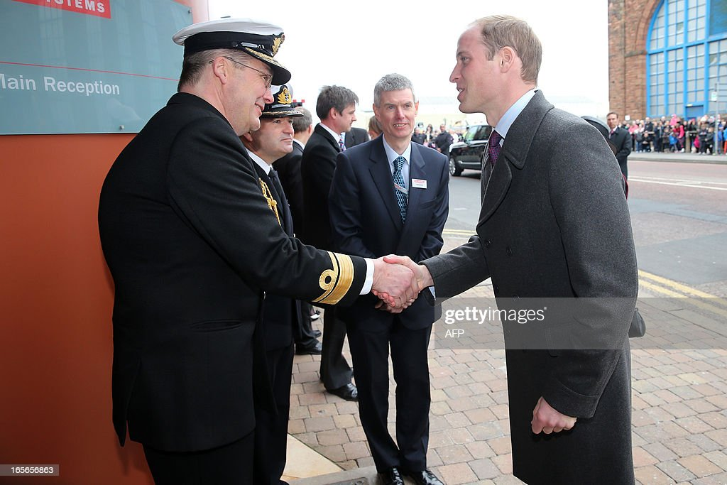 Britain's Prince William, Duke of Cambridge (R) shakes hands with Rear-Admiral Simon Robert Lister (L) as he arrives at the Astute-class Submarine Building at BAE Systems in Barrow-in-Furness, Cumbria, northern England, on April 5, 2013. The Duke of Cambridge is Commodore-in-Chief of the Royal Navy Submarine Service and during their visit they toured the offices of Vanguard replacement programme and meet with the crew of Artful and their families, who are now based in Barrow.