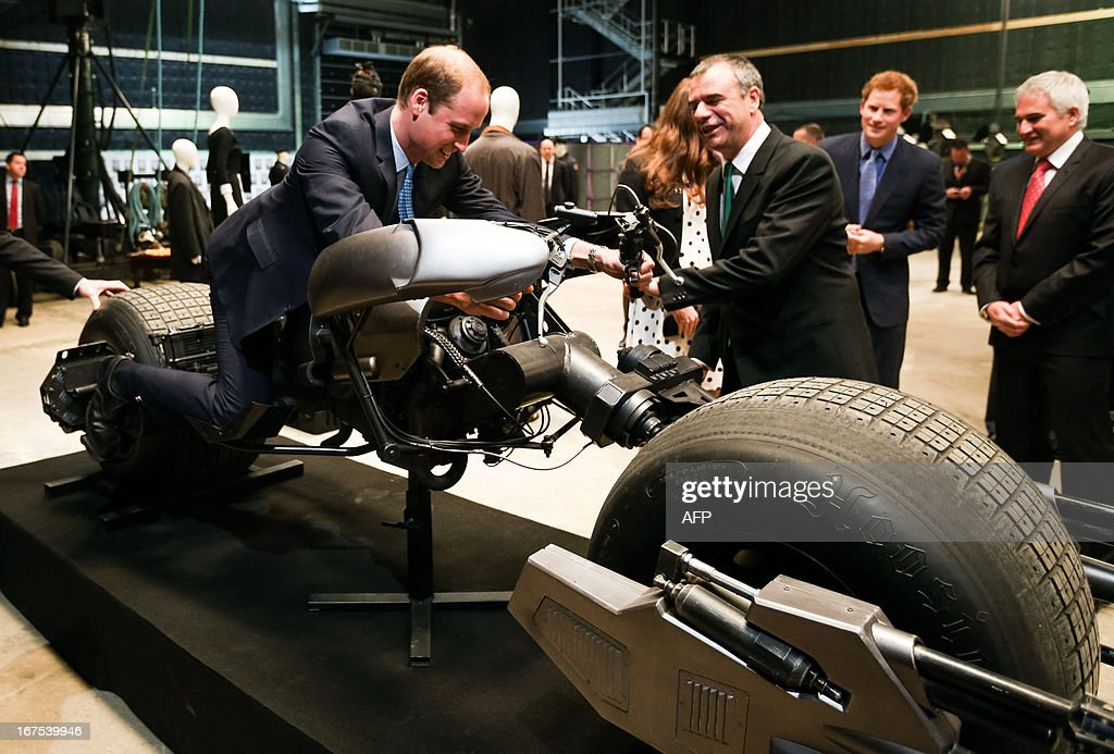 Britain's Prince William, Duke of Cambridge, sits on a 'Batman Bike' which was used in the Batman films during the Inauguration Of Warner Bros Studios in Leavesden, north London, on April 26, 2013.