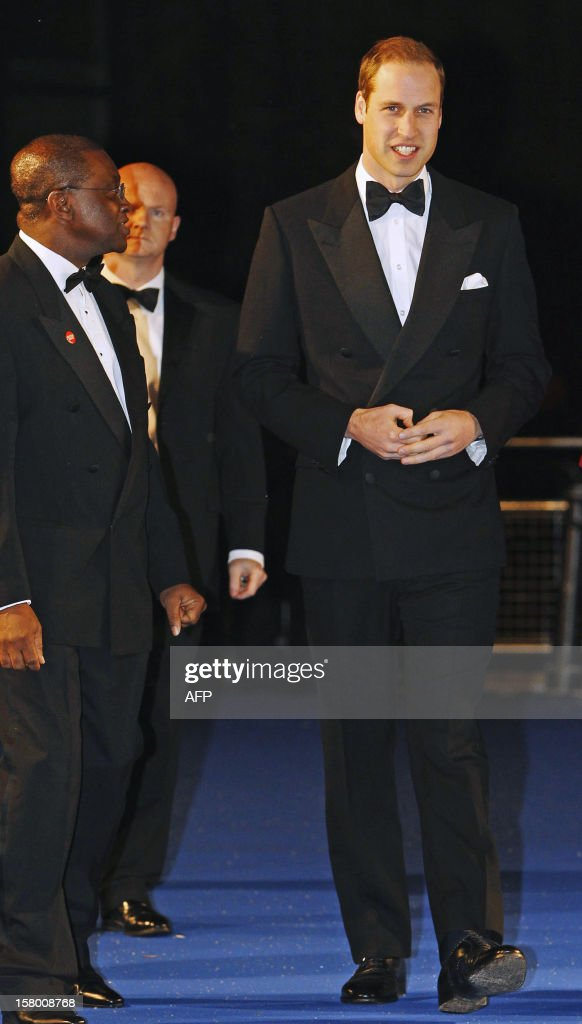 Britain's Prince William, Duke of Cambridge (R) smiles as he arrives at the Winter Whites Gala in aid of the Centrepoint charity at the Royal Albert Hall in central London on December 8, 2012. The Prince attended the gala in aid of the charity of which he is patron. The London hospital that treated Prince William's pregnant wife Catherine and where a nurse was found dead after being hoaxed by an Australian radio show on Saturday wrote to the station condemning the 'truly appalling' stunt. AFP PHOTO / POOL / LUKE MACGREGOR