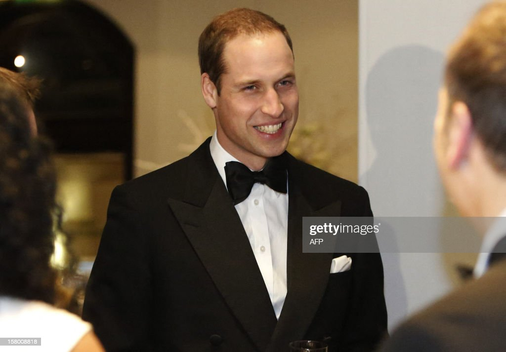Britain's Prince William, Duke of Cambridge smiles as he meets people at the Winter Whites Gala in aid of the Centrepoint charity at the Royal Albert Hall in central London on December 8, 2012. The Prince attended the gala in aid of the charity of which he is patron. The London hospital that treated Prince William's pregnant wife Catherine and where a nurse was found dead after being hoaxed by an Australian radio show on Saturday wrote to the station condemning the 'truly appalling' stunt.