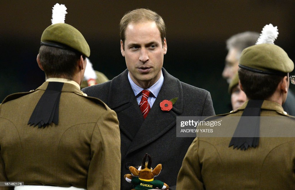 Britain's Prince William, Duke of Cambridge (C), speaks to soldiers at the end of the International rugby union test match between Wales and South Africa at the Millennium Stadium in Cardiff, south Wales, on November 9, 2013. South Africa won the match 24-15.