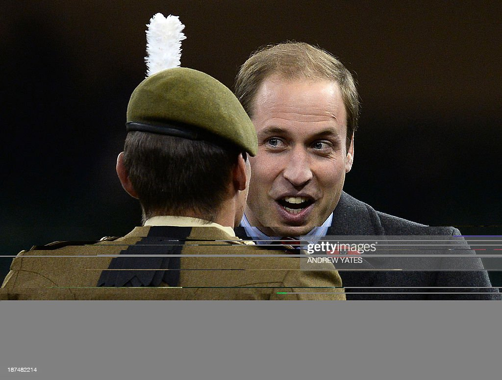 Britain's Prince William, Duke of Cambridge (R), speaks to soldiers at the end of the International rugby union test match between Wales and South Africa at the Millennium Stadium in Cardiff, south Wales, on November 9, 2013. South Africa won the match 24-15.